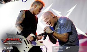 Singer John Bush on stage with James Hetfield. Photo by Tim Mosenfelder