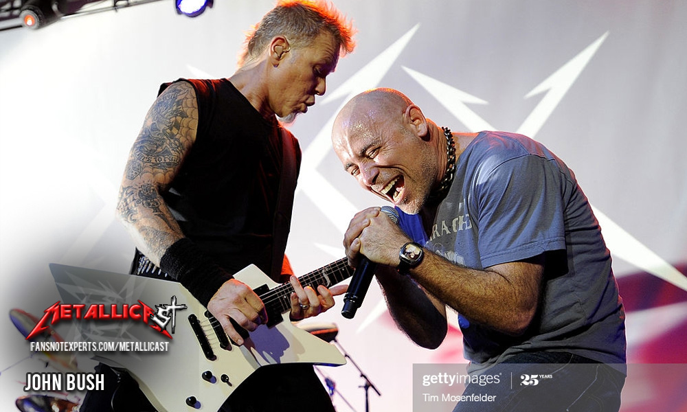 Singer John Bush on stage with James Hetfield. Photo by Tim Mosenfelder